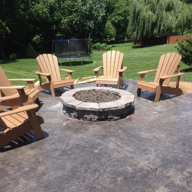 fire pit on patio with wood chairs